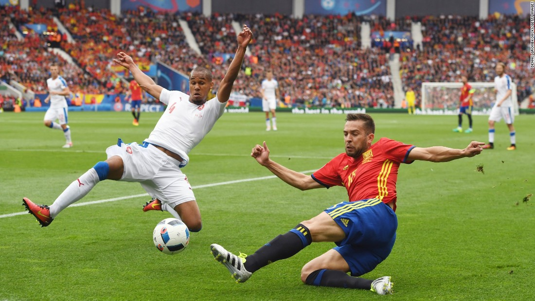 Czech defender Theodor Gebre Selassie, left, tries to block a pass by Spain's Jordi Alba.