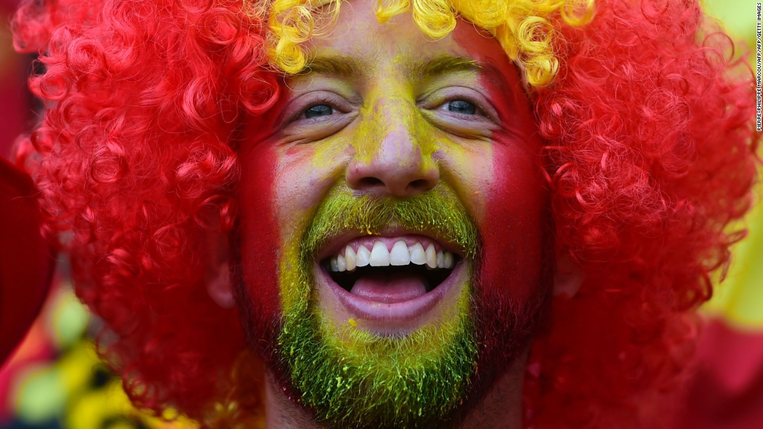 A Spain supporter smiles ahead of the match in Toulouse, France.