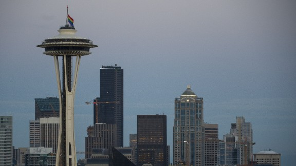 A rainbow flag flies at half-staff on the Space Needle in Seattle on June 12.