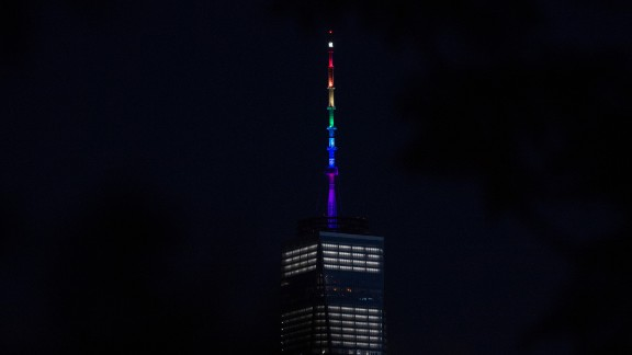One World Trade Center is lit in rainbow colors June 12 in New York.