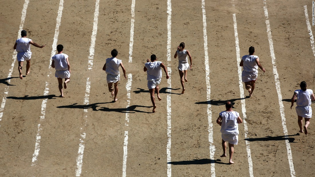 Barefoot runners wear tunics as they race in Nemea, Greece, on Saturday, June 11. It was part of the Modern Nemean Games, an annual re-enactment of the ancient Greek competition.