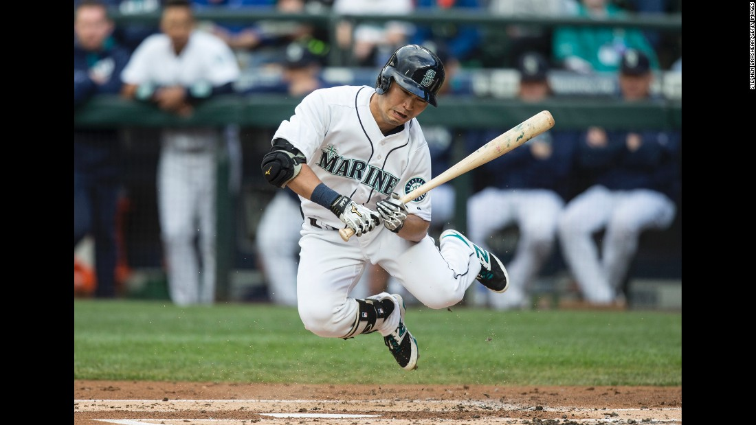Norichika Aoki jumps after being hit by a pitch in Seattle on Saturday, June 11.