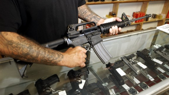 DENVER - SEPTEMBER 13:  An employee of Dave's Guns holds a Colt AR-15, now legal with a bayonet mount, flash suppressor, collapsible stock and a high capacity magazine that holds more than 30 rounds, September 13, 2004 in Denver, Colorado. Between 1994 and September 13, 2004 these guns could only be sold to law enforcement and military but now it is legal for civilians to purchase them due to the expiration of the Brady Bill.  (Photo by Thomas Cooper/Getty Images)