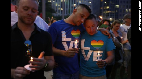 ORLANDO, FL - JUNE 13:  People hold candles during a memorial service at the Dr. Phillips Center for the Performing Arts for the victims of the Pulse gay nightclub shooting where Omar Mateen allegedly killed 49 people, June 13, 2016 in Orlando, Florida. At least 49 people were killed and 53 others injured in what is the deadliest mass shooting in the country's history.  (Photo by Joe Raedle/Getty Images)