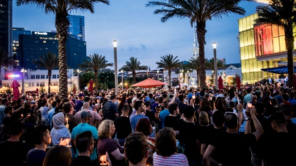 Residents of Orlando light candles during the first official vigil in the wake of the deadly attack at Pulse Orlando.