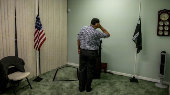 Tareq Dajani leads a prayer service at the Baitul-Aafiyat Mosque in Orlando, honoring Sunday