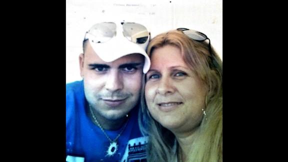 Maria Elena Lopez poses with her son, Alexander Vergara Lopez, in a family photo taken in Cuba.