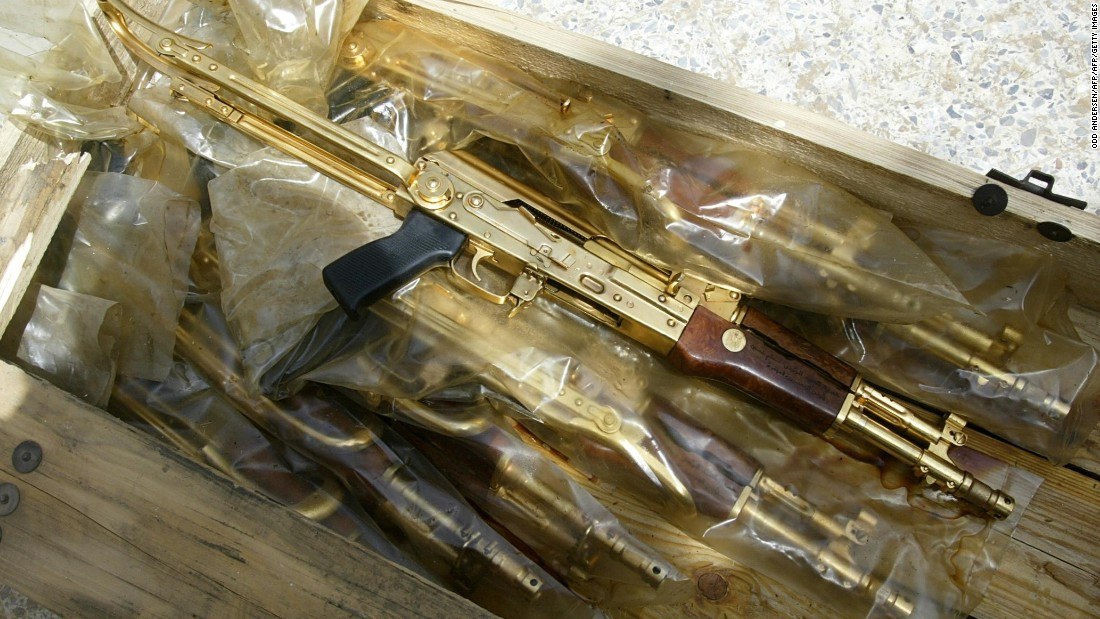 "Gold Kalashnikov rifles with the Arabic inscription ""A gift from Iraqi President Saddam Hussein"" were found in plastic bags in Baghdad, on April 12, 2003."
