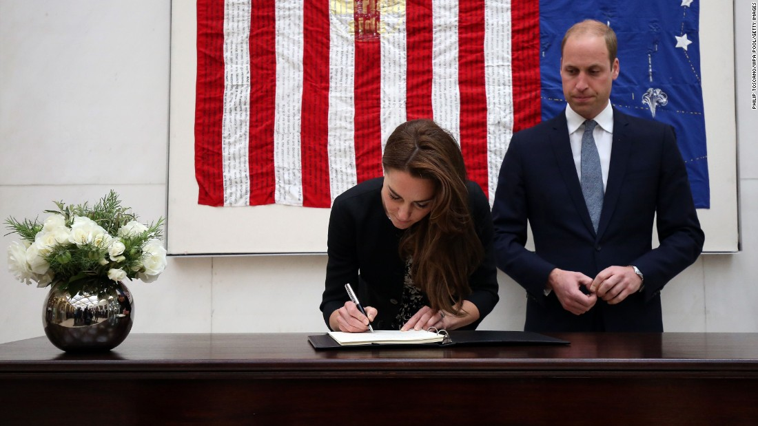 Britain's Prince William and his wife, Catherine, sign a book of condolences at the U.S. Embassy in London on June 14.