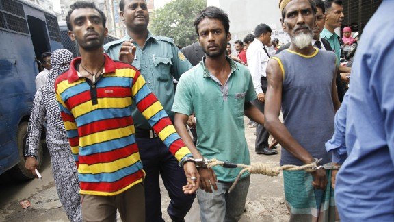Bangladeshi police escort arrested men  in Dhaka on June 12, 2016. Over 14,000 people, including suspected ordinary criminals, have been detained after police launched a controversial anti-militant drive across the Muslim-majority nation following a spate of gruesome murders.