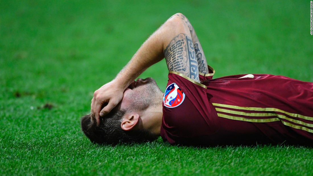 Russian forward Fedor Smolov lies on the field at the end of the match.