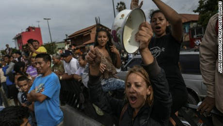 Residents of the Catia neighborhood rally to protest a lack of food in Caracas on June 14.
