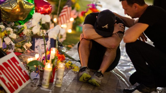 Jean Dasilva, left, is comforted by Felipe Soto as they mourn the loss of their friend Javier Jorge-Reyes on June 14. They were visiting a makeshift memorial at Pulse, the gay nightclub where the shooting took place.