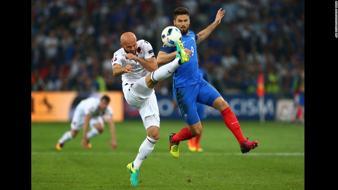Albania's Arlind Ajeti, left, defends against French striker Olivier Giroud.