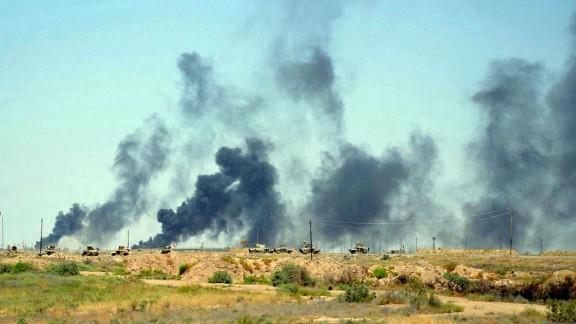 Smoke rises after airstrikes by U.S.-led coalition warplanes on Sunday, June 12.