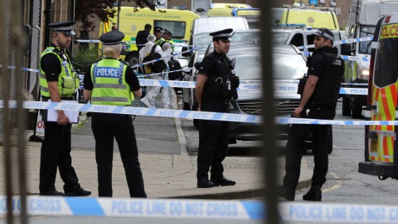 Police gather near the scene of the attack in Birstall on June 16.