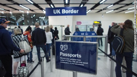 Border Force check the passports of passengers arriving at Gatwick Airport on May 28, 2014 in London, England.