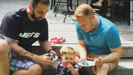 Rocco Forgione, left, his husband, Corey Martin, and their son, Forge, 2.