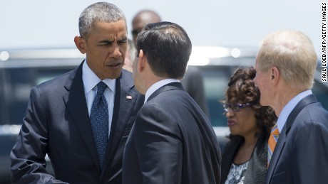 US President Barack Obama speaks with US Senator Marco Rubio, Republican of Florida, after Obama arrived at Orlando International Airport in Orlando, Florida, June 16, 2016.