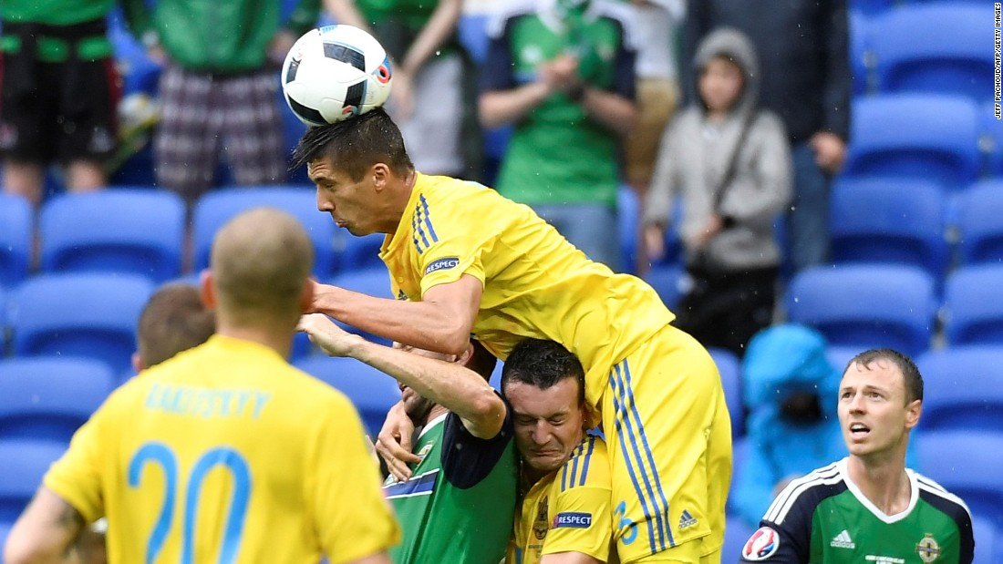 Ukrainian defender Yevhen Khacheridi heads the ball.