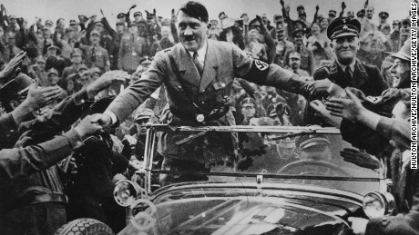 1933:  Adolf Hitler (1889 - 1945), chancellor of Germany, is welcomed by supporters at Nuremberg.  (Photo by Hulton Archive/Getty Images)