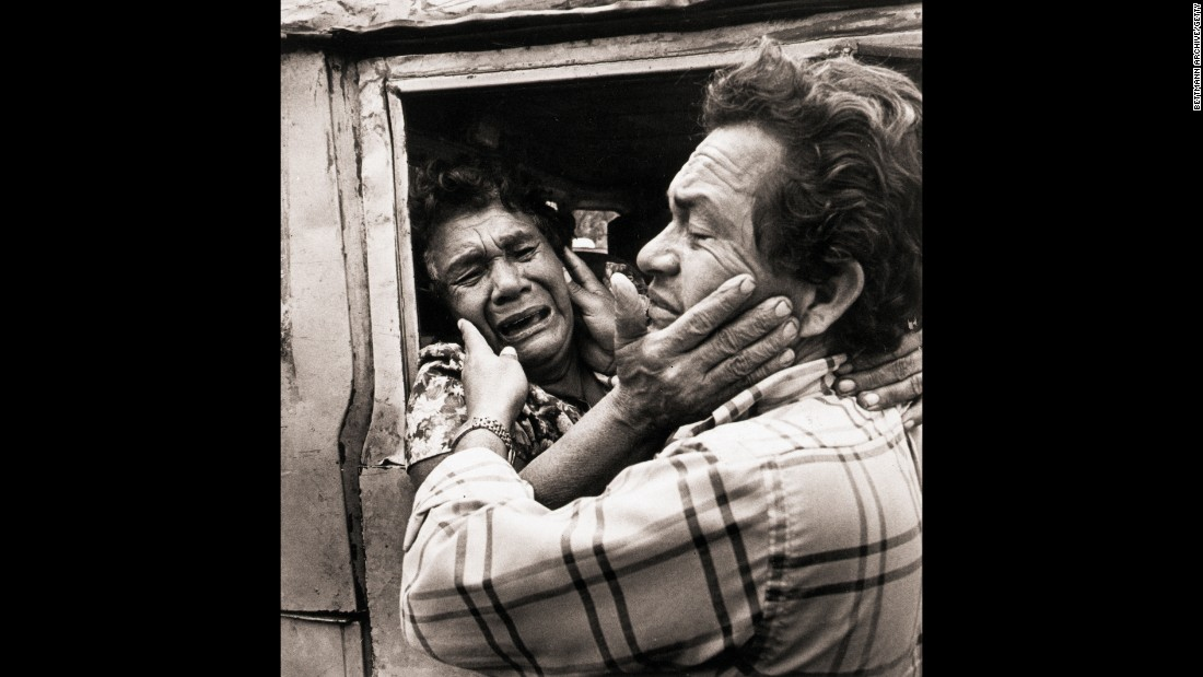 Thousands of Salvadorans and Nicaraguans left their homes to escape the repression and violence associated with civil war. In the 1980s, Washington welcomed 400,000 Nicaraguan refugees. Far fewer Salvadorans were given asylum, although many stayed in America undocumented. In this image, a refugee woman is reunited with her son after being evacuated from her war-torn town in El Salvador in 1983.