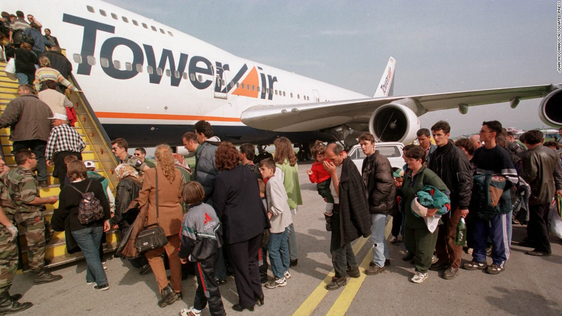 Ethnic Albanian refugees wait in Skopje, Macedonia, to board a flight for Fort Dix, New Jersey, in 1999. They were part of an exodus of 200,000 people from war-torn Kosovo.