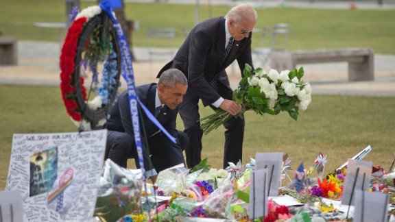 President Obama and Vice President Joe Biden place flowers at a memorial on Thursday, June 16, for the victims of the nightclub shooting in Orlando. At least 49 people were killed in the massacre, the deadliest mass shooting in U.S. history.