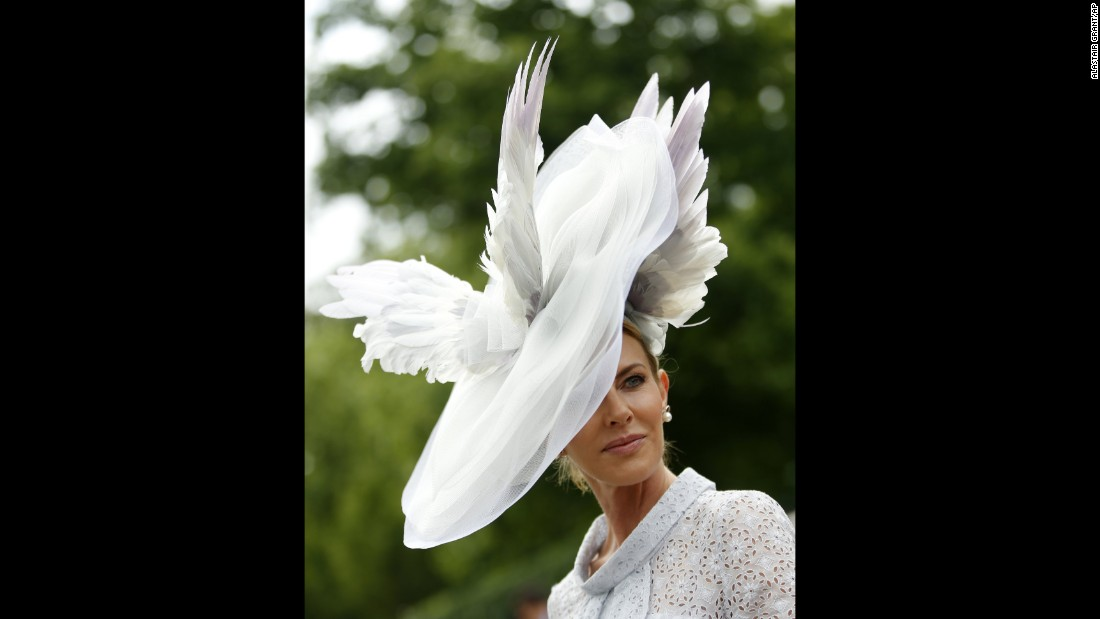 Belinda Studwick sports an enormous winged hat.