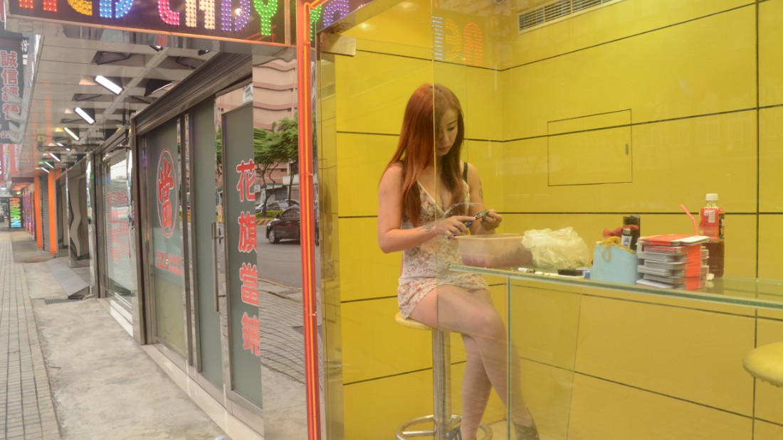 "Along the streets and highways in Taiwan  -- especially in the cities' outskirts and in the countryside -- are neon-lit booths with scantily clad ""betel nut beauties."""