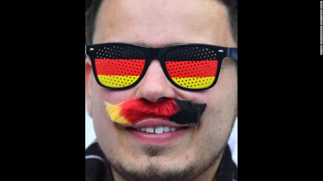 A Germany fan supports his team before the match.