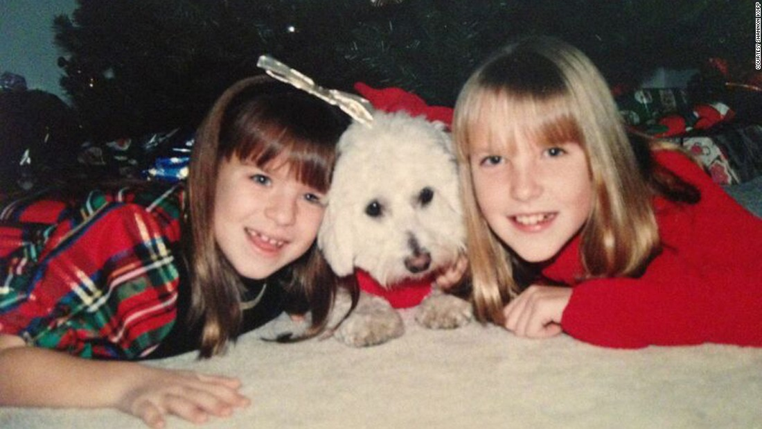 Shannon Kopp at age 11, right, with her sister, Julie, 8, and their childhood dog Sugar on Christmas in 1995.