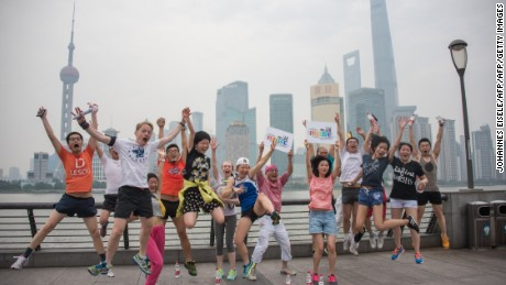 Participants in Shanghai Pride pose for pictures in front of the financial district on June 13, 2015.