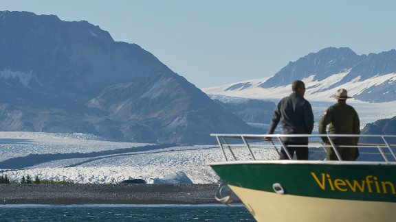 US President Barack Obama looks at Bear Glacier during a boat tour of the Kenai Fjords National Park on September 1, 2015 in Seward, Alaska. Bear Glacier is the largest glacier in Kenai Fjords National Park.