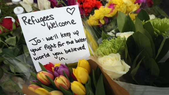 Flowers and personal messages are seen on Parliament Square on June 17.