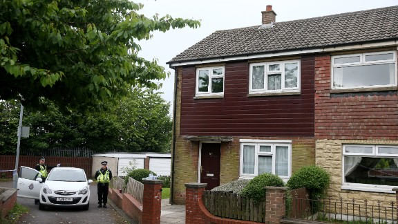 Police search Mair's home in Birstall on June 17.