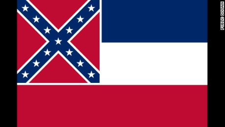 "Adopted by the Mississippi Legislature in 1894. The thirteen stars, sometimes said to represent the number Confederate States and those that might have been Confederate, are said to represent the ""original number of States of the Union"" in the original description."