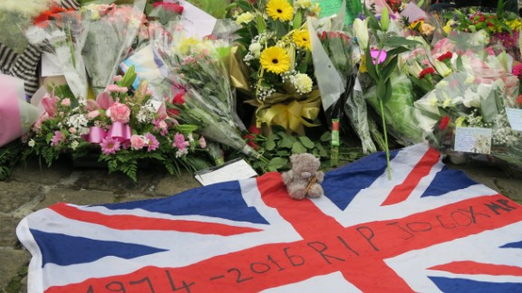 A Union flag with the years of her birth and death lie amid floral tributes to slain British MP Jo Cox, in the town where she was killed, Birstall.