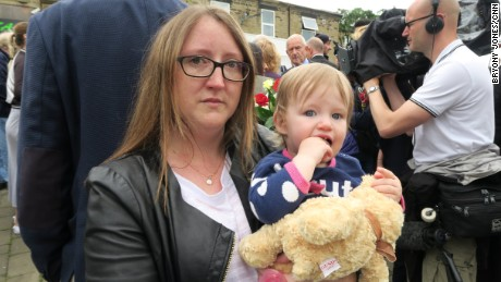 Laura Woodbridge and her daughter Lyla came to leave flowers at the makeshift memorial to Jo Cox.