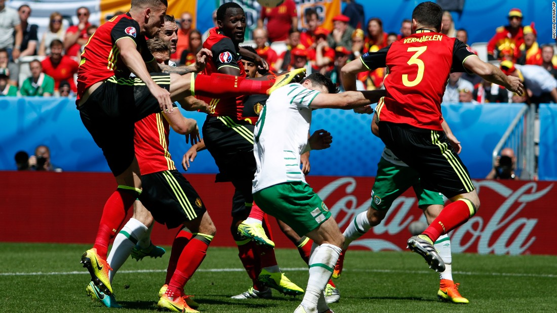 Belgium's Toby Alderweireld, left, hits Ireland's Shane Long in the head with his boot.