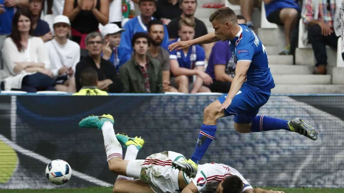 Iceland defender Ari Skulason, right, vies with Hungary's Richard Guzmics.