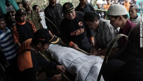 Indonesian villagers prepare for the funeral of a landslide victim in Banjarnegara on Sunday.