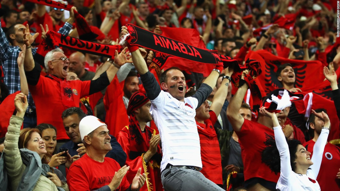 Albania supporters celebrate their team's  goal against Romania on Sunday in Lyon, France. Albania defeated Romania 1-0.