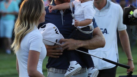 Johnson of the United States celebrates with partner Paulina Gretzky and son Tatum on June 19.