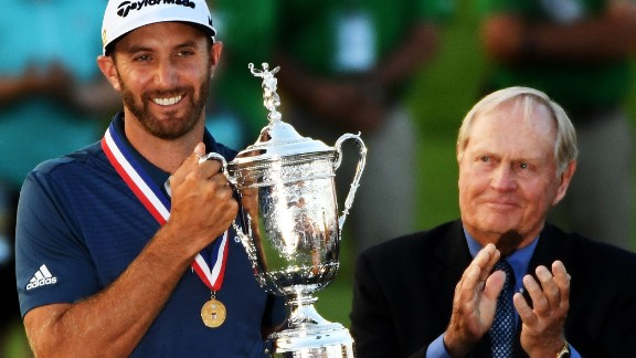 Dustin Johnson holds his winner's trophy alongside Jack Nicklaus after winning the U.S. Open at Oakmont Country Club on Sunday, June 19, in Oakmont, Pennsylvania.