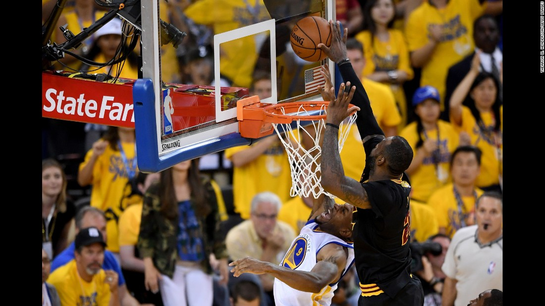 James comes up with a key block of Andre Iguodala just before Irving's 3-pointer. The game was tied at the time.