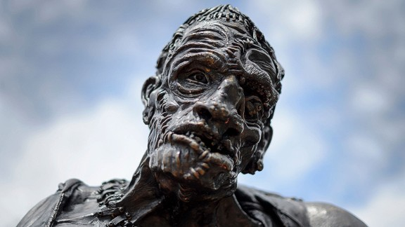 TO GO WITH AFP STORY BY NINA LARSON A picture taken on May 9, 2016 shows a statue of Frankenstein's monster in Geneva. Frankenstein, the story of a scientist who brings to life a cadaver and causes his own downfall, has for two centuries given voice to modern anxiety surrounding science's unrelenting advance. To mark the 200 years since England's Mary Shelley first imagined the ultimate horror story during a visit to a frigid, rain-drenched Switzerland, an exhibit opens in Geneva Friday called 'Frankenstein, Creation of Darkness'. / AFP / FABRICE COFFRINI (Photo credit should read FABRICE COFFRINI/AFP/Getty Images)