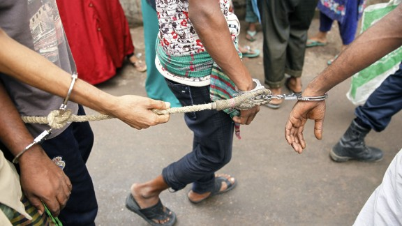 Bangladeshi police escort arrested men in Dhaka on June 12, 2016, who were detained during a anti-militant crackdown across the country . Around 5,000 people, including suspected ordinary criminals with existing warrants against them, have been arrested after police launched a controversial anti-militant drive across the Muslim-majority nation following a spate of gruesome murders. / AFP / -        (Photo credit should read -/AFP/Getty Images)