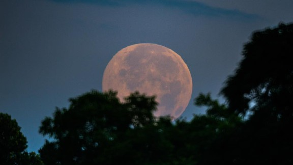 The moon looks majestic at sunrise for summer solstice over Kathleen, Georgia.