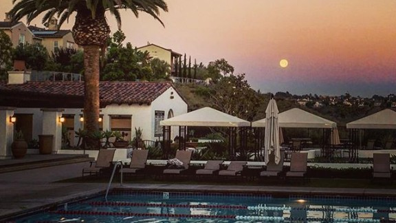 The moon says hello as it peeks over a pool in San Diego, California, on June 20.
